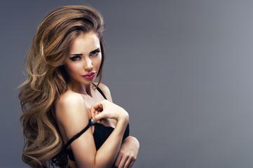 Beautiful sexy blonde woman wearing black sensual lingerie