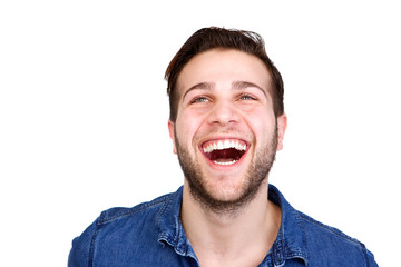 Cheerful young man laughing