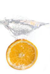 Fototapeta dropped orange in water isolated
