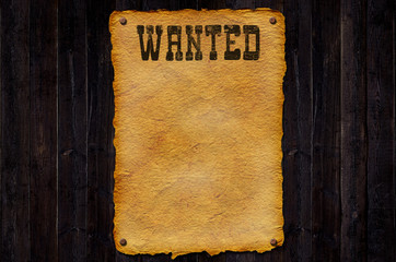 Wanted on Wood Background