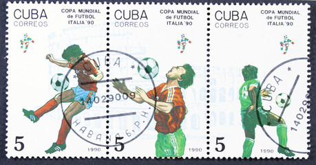 Stamp printed by CUBA shows football players.