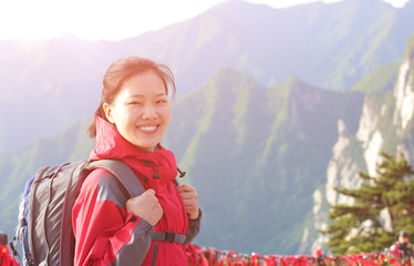 woman hiker stand at peak of mountain huashan