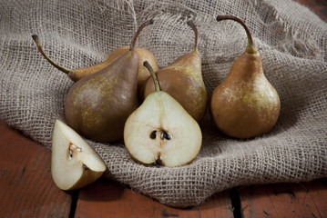 pears on sackcloth on wooden rustic table