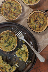 homemade vegetarian tartellettes with leeks rocket on plate
