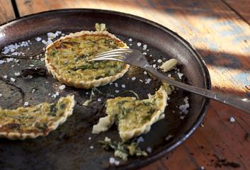 homemade vegetarian tartellettes on plate on wooden table