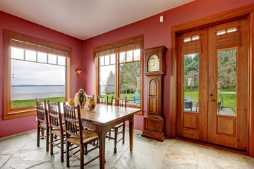 Burgundy dining room with antique grandfather clock
