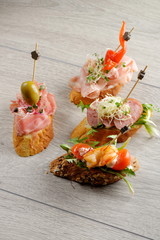 Tapas on Crusty Bread - Selection of Spanish tapas served