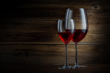 glasses of wine on a wooden background