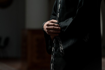 Close-Up Of Male Hands Praying In Mosque