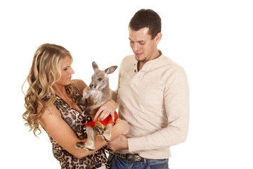 couple holding kangaroo look at him