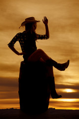 silhouette cowgirl on barrel sit wave