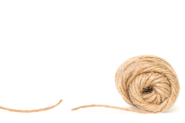 Roll and cut piece of rough texture twine string,isolated.