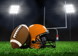 Football Ball and Helmet On Grass under Spotlights