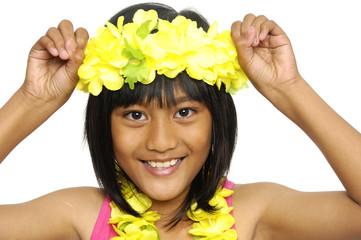 little cute girl wearing a Hawaiian lei-close up
