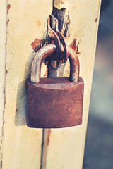 old and rusty padlock in retro color effect