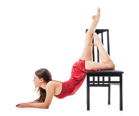 Modern dancing woman sitting on chair Isolated