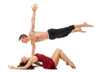 Couple of ballet dancers posing isolated