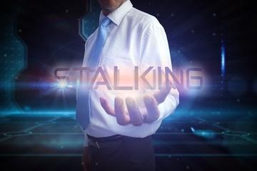 Businessman presenting the word stalking