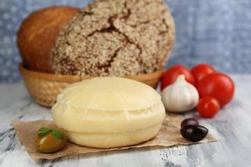 Tasty Italian cheese on wooden table