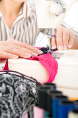 Female taylor working on a sewing machine