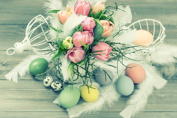 pastel tulip flowers and easter eggs. retro style