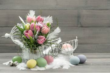 easter composition with eggs and pastel tulips