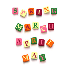 "Words ""spring"", ""march"", ""april"" , ""may"" with colorful blocks"