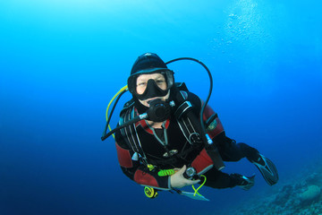 Happy woman scuba diving