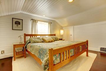 Wood plank paneled bedroom