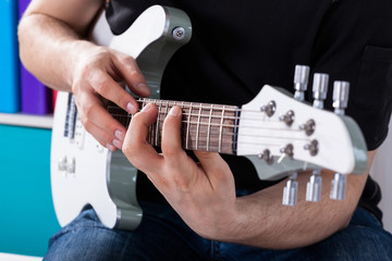 Man playing guitar his favourite song