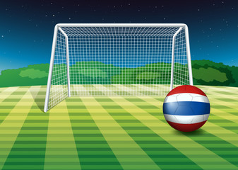 A ball at the field with the flag of Thailand