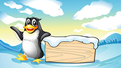 A penguin beside the empty wooden board