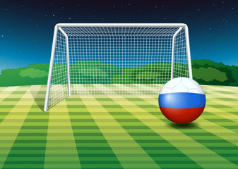 A soccer ball near the net with the flag of Netherlands