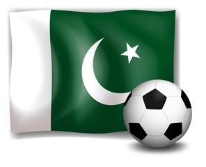 A soccer ball and the flag of Pakistan