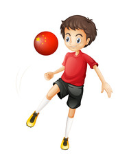 A boy using the soccer ball with the flag of China