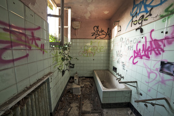 Dirty and decayed bathroom in abandoned house