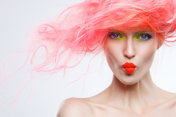 Portrait of beautiful girl with pink hair, kisses