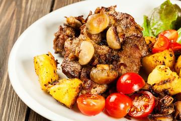 Fried pork chop with mushrooms