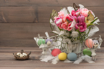 pink tulips, butterflies and colored easter eggs