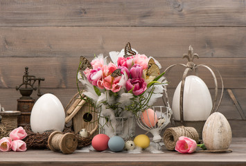 pink tulips and colored easter eggs