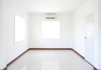 Empty room with windows and door.