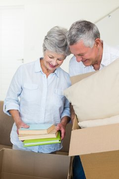 Happy senior couple moving into new home
