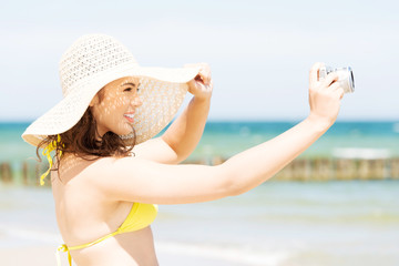 Summer woman making photos