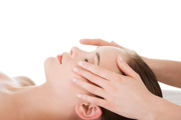 Relaxed woman enjoy receiving face massage