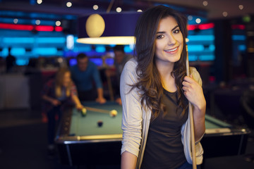 Portrait of beautiful woman in billiard club