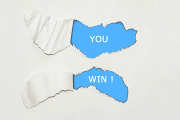 Ripped paper - you win text