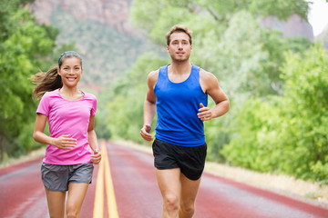 Runners couple in jogging exercise outside
