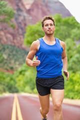 Athlete runner running on road
