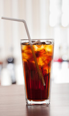 glass of cola with ice on the bar