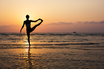 Wall Mural - Yoga silhouette on the beach
